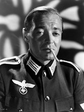 Peter Lorre Smoking Cigarette wearing Rank Official Uniform in Black and White Portrait