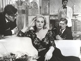 Anita Ekberg sitting on the Couch Listening to a Guy in Classic Portrait