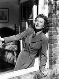 Greer Garson on a Long Sleeve Coat Leaning on a Window