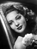 Linda Darnell posed with A Flower in Her Chest in Black and White