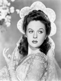 Susan Hayward wearing an Embroidered Dress with Veil and Head Dress