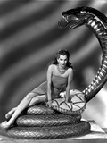 Maria Montez sitting on Snake Statue  wearing Sexy Dress with Pillow