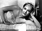 Maria Montez Lying in White Strapless Dress with Headdress