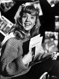 Hayley Mills wearing a Knitted Sweater Holding a Paper
