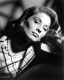 Suzy Parker wearing a Printed Blouse with Necklace and Earrings