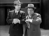 Abbott & Costello in Suit and Hat Looking at the Time