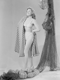 Susan Hayward wearing a White Two Piece in with Printed Cloth