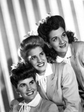Andrew Sisters smiling and Looking Away in a Group Picture in Classic