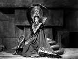 Maria Montez sitting on Snake Statue  wearing Long Classic Gown
