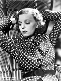 Margaret Sullivan Posed in polka dot with Two Hands Raise