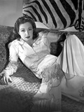 Nina Foch on Printed Dress sitting on a Native Handcrafted Chair