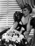 Claudette Colbert sitting in Black Elegant Dress with Flowers