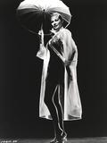 Anita Ekberg wearing a Rain Coat Holding a Umbrella in Classic Portrait
