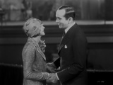 Al Jolson Holding a Woman's Hand While Talking to Her
