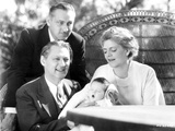 John Barrymore Hanging Out with a Family in a Classic Portrait