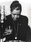 Billie Holiday Looking Down in Black Dress with Glass