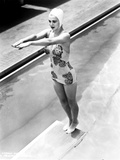 Carole Landis on a Printed Swimsuit and standing on a Dive Board