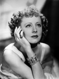 Irene Dunne sitting and Looking Up and Face Leaning on Hand