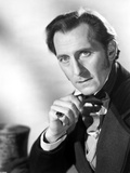 Peter Cushing Posed in Black Suit With Head Leaning on Hand