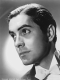 Tyrone  Powers wearing Yellow Sweater in Close Up Portrait