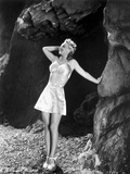 Carole Landis in Printed Bra and Skirt  Hand Leaning on Rock