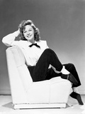 Susan Hayward sitting on Couch in White Long Sleeve Blouse