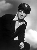 Karl Malden Posed in Black Suit With Black and White Background