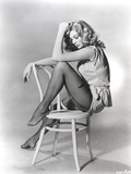 Anita Ekberg sitting on a Chair in a Classic Portrait