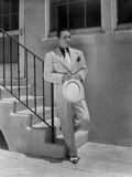 George Raft Leaning on Stair Railing in Formal Outfit With Hat Portrait