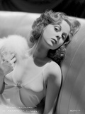 Susan Hayward sitting and Leaning on Couch with Furry Cloth