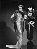 Alice Brady Leaning on a Big Vase wearing a Glossy Dress