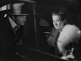Citizen Kane Man Talking to Woman with Fur Coat in Movie Scene