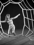 Debbie Reynolds standing in Checkered Top on a Spider Web