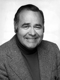 Jonathan Winters Posed in Black Suit With White Background