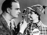 Edgar Bergen Checking Puppet's Face With Magnifying Glass