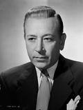 George Raft Posed in Suit with an Expressionless Face
