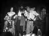 Linda Darnell posed with Two Man in Pirate Outfits in Black and White