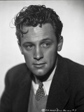 William Holden Looking Away in Black Coat with Curly Hairdo