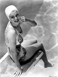 Carole Landis on Printed Swimsuit and sitting on a Dive Board
