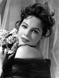 Leslie Caron Portrait in Classic with A Bouquet of Flowers