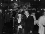 Al Jolson Accompanying a Woman in a Crowd in a Classic Portrait