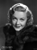 Madeleine Carroll Portrait in Black Dress with a Smile