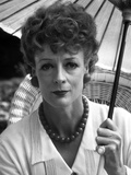 Maggie Smith Holding Umbrella in White Dress with Necklace