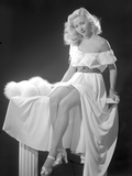 Gloria Grahame Posed in a White Dress with Black Background