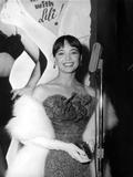 Leslie Caron Smiles wearing Elegant Gown with Fur Coat