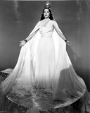 Maria Montez Posed in Big and Long White Gown with Arm's Wide Open