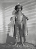 Shirley Temple wearing a Dressing Gown in a Portrait