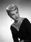 Judy Holliday wearing a V-Neck Dress in a Portrait