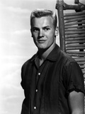 Tab Hunter Posed in Black Polo With White Background