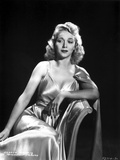 Carole Landis on a Silk Dress sitting and Leaning